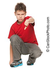 Upset boy holds his thumb down - An upset boy in red shirt...