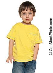 Serious little boy in yellow shirt