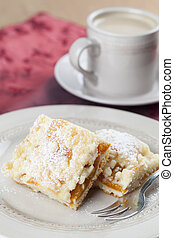Apricot crumble cake and coffee Shallow dof