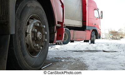 Trucks TIR in the winter - Heavy trucks on parking