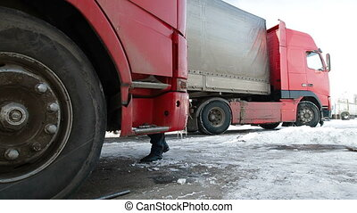 Truck drivers preparing for trip in winter