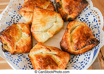 Pirogue - Individual-sized baked or fried buns stuffed with...