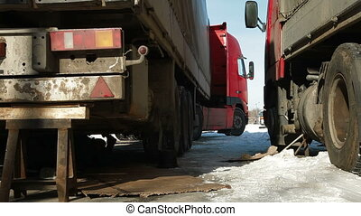 Trucking - The driver repairing heavy commercial truck