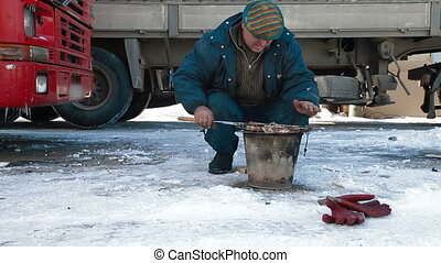 quick lunch on the road - Truck driver is resting after a...