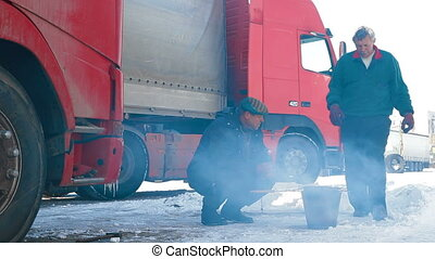 Truck drivers lunch on the way - Truck drivers is resting...