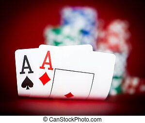 chips and two aces - Stack of chips and two aces on a poker...