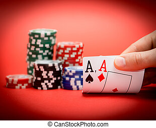 chips and two aces - Stack of chips and two aces on a red...