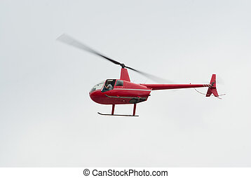 "Red R-44 helicopter - Red Robinson R-44 ""Raven"" helicopter"