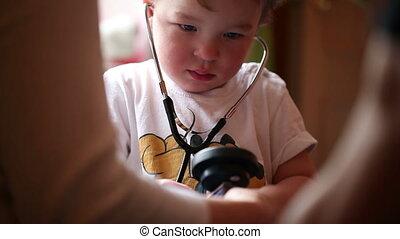 Boy plays a doctor.