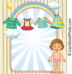 A baby below the hanging clothes