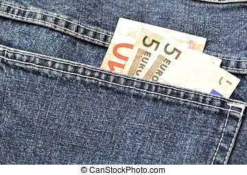 Money in the pocket of a pair of jeans