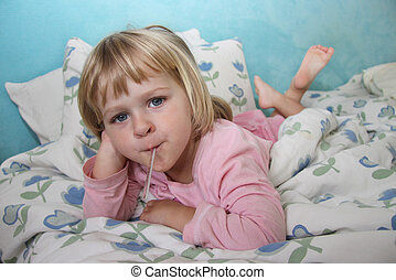 Sick girl in bed - A sick girl lying in bed, having her...