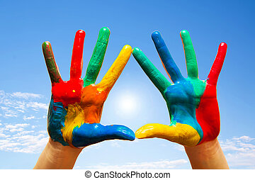 Painted hands, colorful fun. blue sky - Painted hands,...