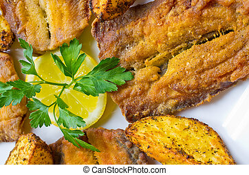 Traditional fried herrings with baked potatoes