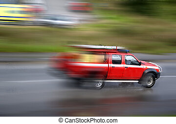Firefighter vehicle panning - A speeding firefighter...