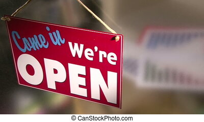 Come in, Out of business - Business owner turns sign from...
