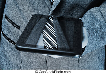 businessman using a tablet computer - detail of a...