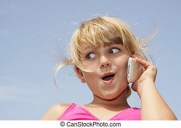 Girl with funny face on phone - A young girl is doing a...