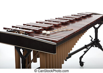 A brown wooden marimba on a white background - A wooden...