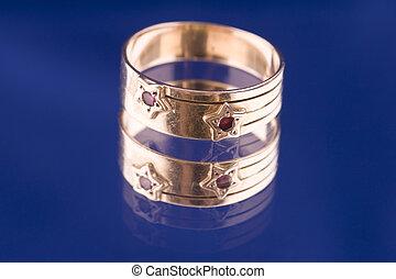 Golden ring macro on blue