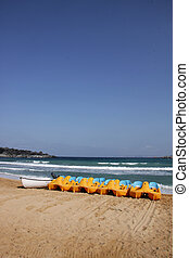 Row of peddle boats - A row of peddle boats on the beach on...