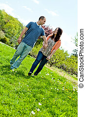 Couple Walking During Spring - Young happy couple enjoying...
