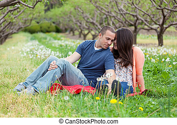 Loving Couple During Spring - Young happy couple enjoying...