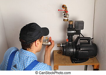 Man installing a water pump