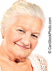 older people - Happy senior woman smiling at the camera....
