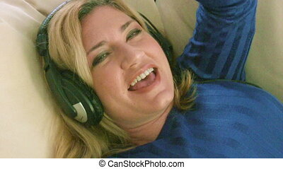 Woman listening to music with headp