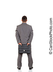 businessman - Rear view of business man hold briefcase,...