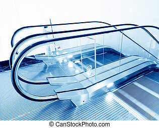 Escalator - Moving escalator in modern building.