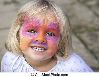 Little girl with face paint - A 4 year old girl smiling at...