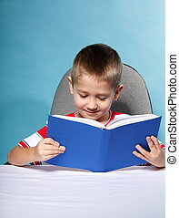 Child boy with a book