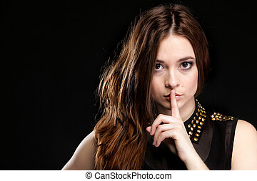 Secret woman. Girl showing hand silence sign