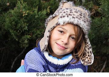 Girl wearing fur hat
