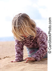 Girl writing in the sand