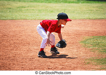 Little league short stop in ready position.