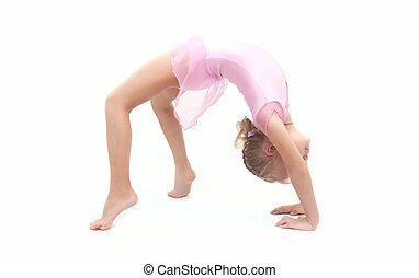 Little child gymnast making elements on a white background...