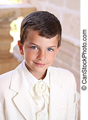 First holy communion - Portrait of boy doing his holy...