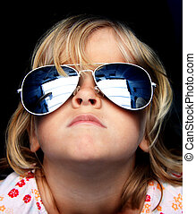 Cool kid with sunglasses - Close up of a young child wearing...