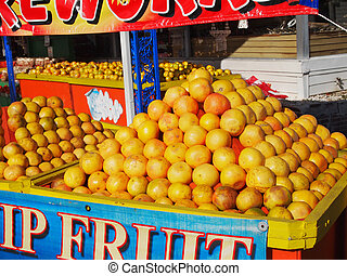 Florida Fruit Stand - A roadside stand displays mountains...