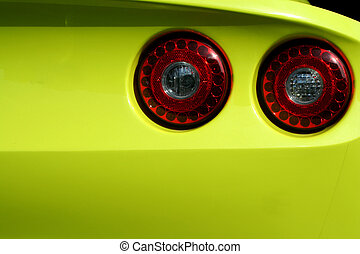 Yellow sports car red tail lights - A Yellow sports car red...