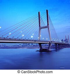 Bridge Night - Night view of the bridge and city in shanghai...