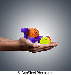 hands holding items of sport, healthy lifestyle concept