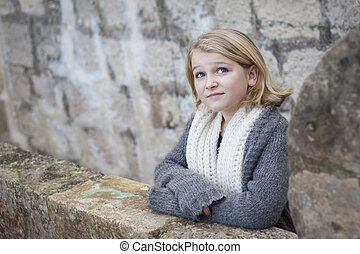 Girl on stone balcony in an old fortress - A beautiful child...