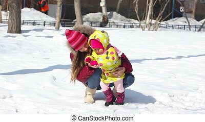 Winter time - Happy mother with her daughter in winter...