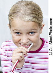 Child brushing teeth - Portrait of young girl brushing...