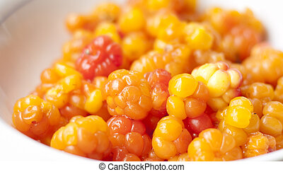 Cloudberry - Close up of cloudberry berries, a rhizomatous...