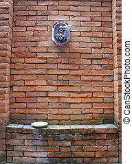 shower - The red brick walls of the old dirty power shower.